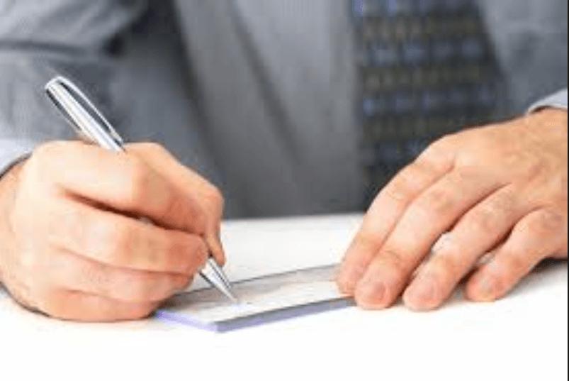 man writing check