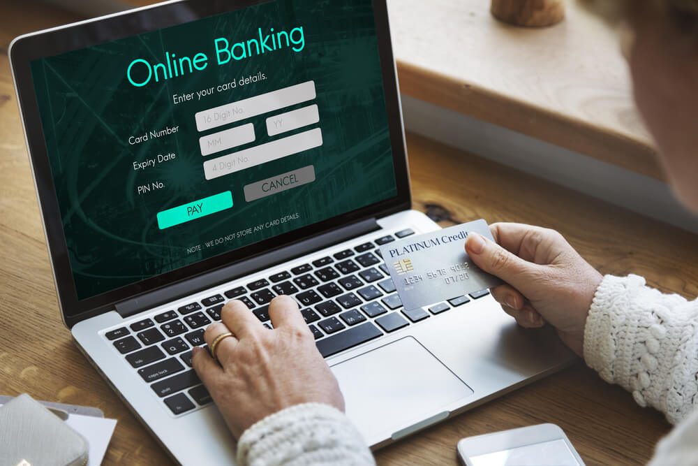 A Woman Paying via Online Banking