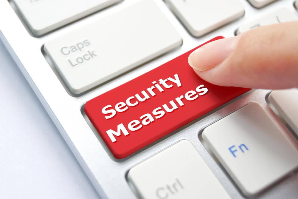 Computer Button Saying Security Measures