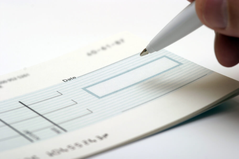 A Generic Blank Check Being Signed