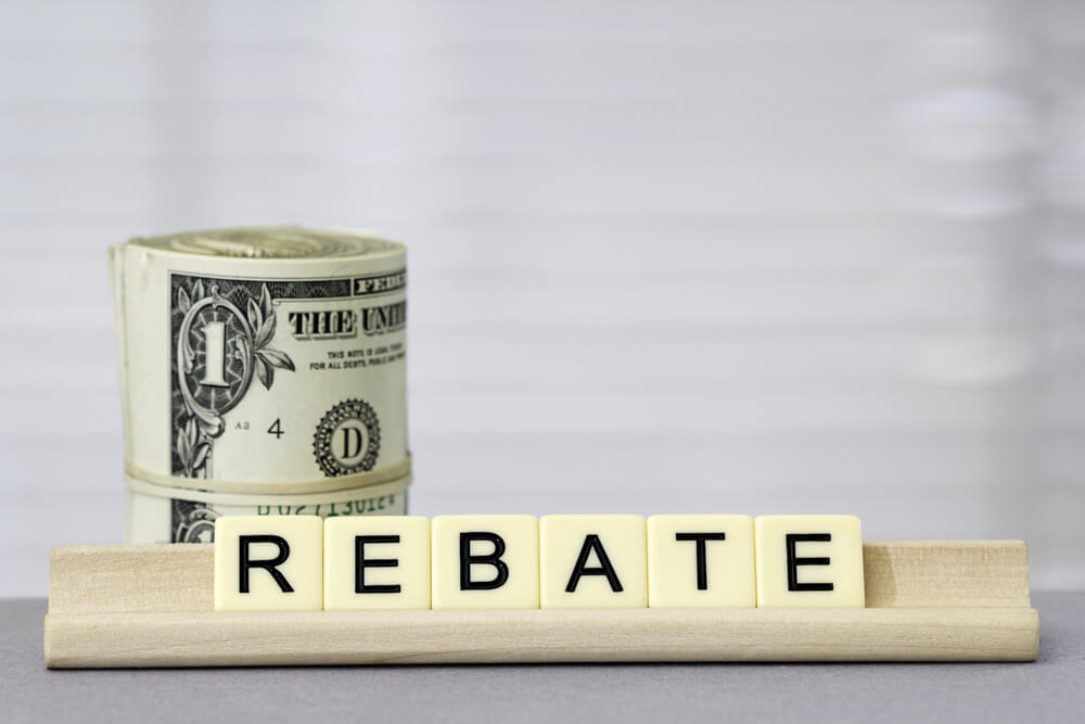 Word Rebate With Dollars in Background