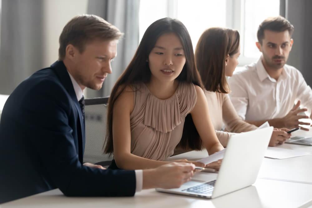 Mentor Coach Helping Asian Female Employee
